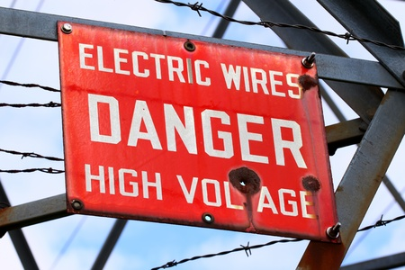 Danger Sign on a powerline tower warning of High Voltage