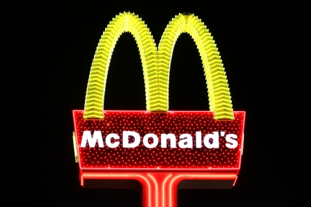 food chain: Las Vegas, USA - October 29, 2011: McDonalds is a fast food chain that operates restaurants around the world.  Seen here is a particularly glitzy McDonalds Sign to fit in with the bright lights of Las Vegas, Nevada. Editorial