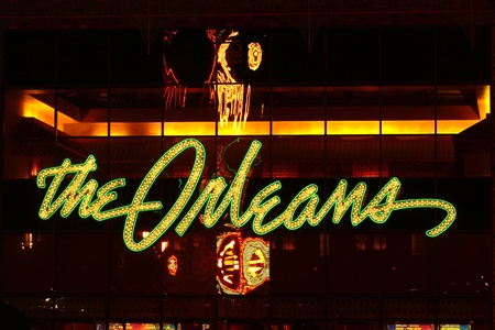 Las Vegas, USA - November 30, 2011: The lights of The Orleans Hotel and Casino Sign above the main entrance showcase the Mardi Gras theme of the property.  The Orleans was opened in Las Vegas, Nevada in the year 1996.