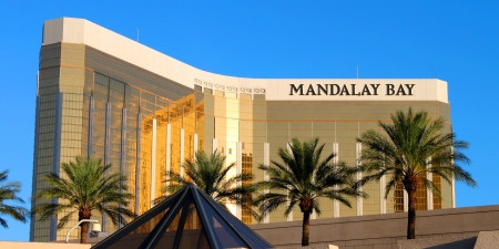 Las Vegas, USA - August 19, 2009: The Mandalay Bay Resort and Casino opened in 1999 in Las Vegas, Nevada.  Seen here is the reflective gold colored exterior of the 44-story tall main building. Editorial