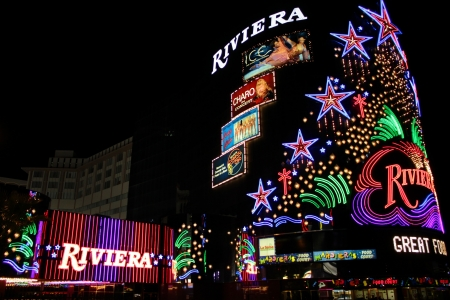 Las Vegas, USA - August 26, 2009: The Riviera Hotel and Casino is one of the first flashy hotel casinos to open on Las Vegas Boulevard in 1955.  Seen here is the brightly decorated sign near the main entrance to the building. Editoriali