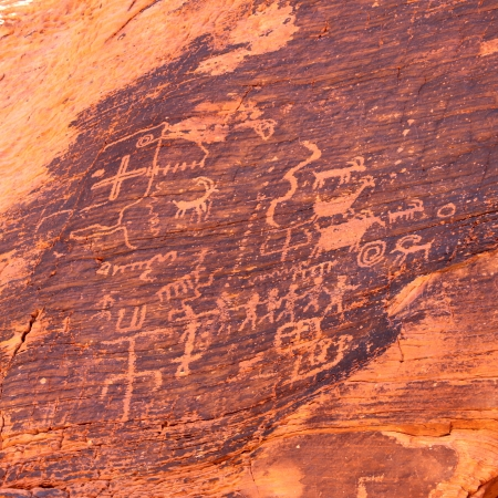 Strange petroglyphs on a rock wall at Valley of Fire State Park in Nevada