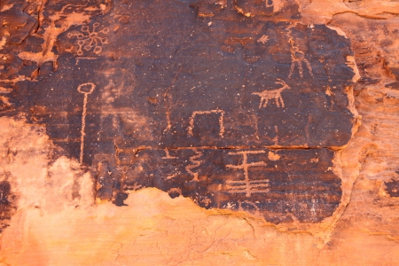 Interesting petroglyphs on a rock wall at Valley of Fire State Park in Nevada photo