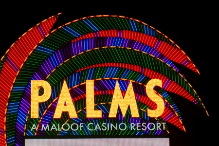 Las Vegas, USA - November 30, 2011: The Palms Resort Casino is a modern styled hotel and casino that opened in 2001 in Las Vegas.  Seen here is the elaborate brightly colored main entrance sign off Flamingo Road. Stock Photo - 13887796