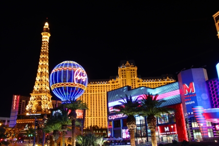 Las Vegas, USA - November 30, 2011: The Paris Las Vegas is a hotel and casino in Nevada.  Seen on the left are the venues replicas of the Eiffel Tower and the Montgolfier Balloon adorned in bright lights.