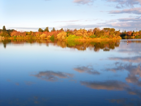 reflect: Beautiful blue skies reflect off Lake Pertobe in the town of Warrnambool Australia