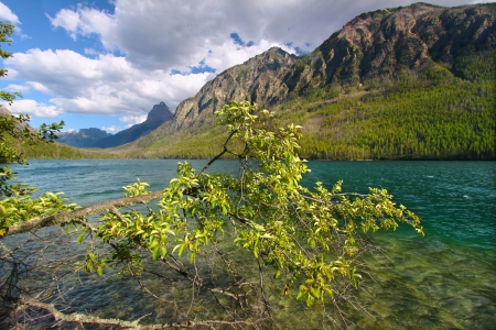 Mountains rise steeply from the shoreline of Kintla Lake in Glacier National Park photo