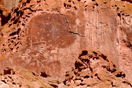 Petroglyphs on the cliff walls of Fremont Indian State Park in Utah photo