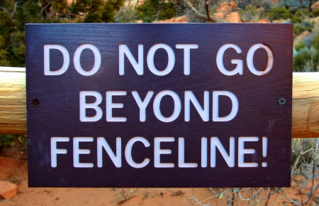 fenceline: Sign reading Do Not Go Beyond Fenceline in a United States national park