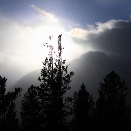 colorado rockies: Snowstorm pushes forward against fading sunlight in the Colorado Rockies.