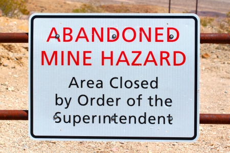 sign post: Sign warning of an Abandoned Mine Hazard in Death Valley National Park