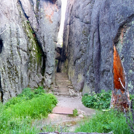narrowly: Hiking trail narrowly passes through large rocks in Custer State Park