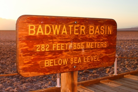 valley below: Sign at the Badwater Basin of California marking the lowest elevation in North America
