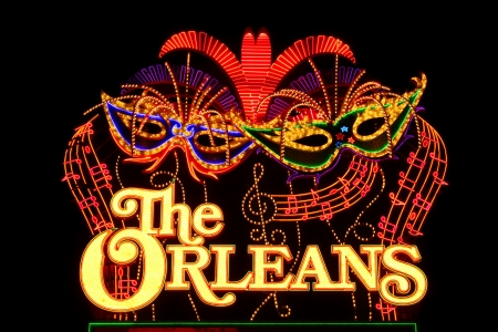 Las Vegas, USA - November 30, 2011: The lights of The Orleans Hotel and Casino Sign showcase the Mardi Gras theme of the property.  The Orleans was opened in Las Vegas, Nevada in the year 1996.