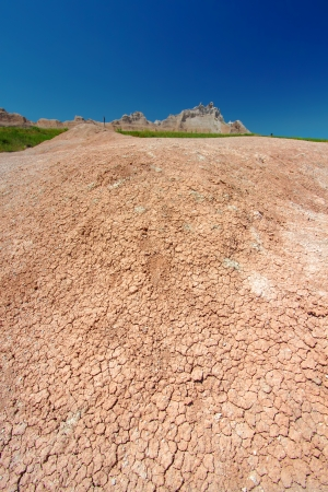Parched substrate of Badlands National Park on a hot summer day photo