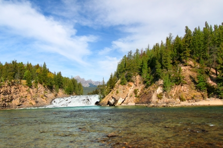 View of Bow Falls flowing through the woodlands of Canada near Banff, Alberta photo