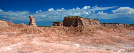 Panorama of the rugged rock formations found in Badlands National Park photo