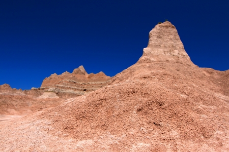 Badlands National Park of South Dakota is a rugged landscape of eroded rock photo