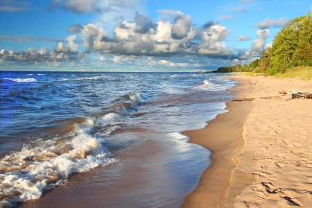 upper peninsula: Waves along the beach of Lake Superior in northern Michigan under beautiful sunlight