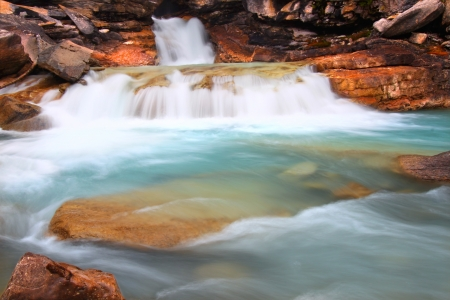 Cascades of glacial water below Twin Falls of Yoho National Park in Canada