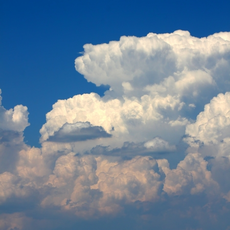 meteorological: cumulonimbus thunderstorm clouds erupt into the sky on a hot summer day Stock Photo
