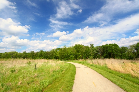 Recreation Path through the prairie at Blackhawk Springs Forest Preserve in Illinois Stock Photo