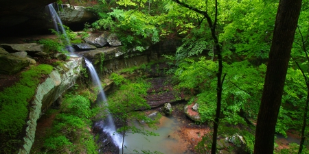 Beautiful waterfall flows into a deep canyon in the woodland of northern Alabama photo