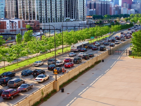 Chicago, USA - June 07, 2005: Rush hour traffic on Lakeshore Drive in Chicago, Illinois.  Lakeshore Drive runs parallel to Lake Michigan and was originally constructed in 1937.