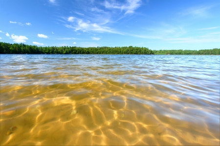 Beautiful swimming beach of a northwoods Wisconsin Lake Stock Photo