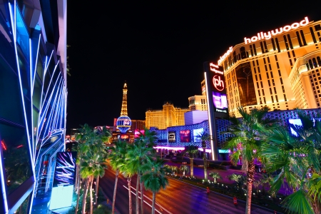 Las Vegas, USA - November 30, 2011: Vivid colors of hotel casinos along the Las Vegas Strip. The Strip is roughly 4 miles long and has many world famous hotel casinos such as Planet Hollywood, Paris Las Vegas, and the Cosmopolitan.