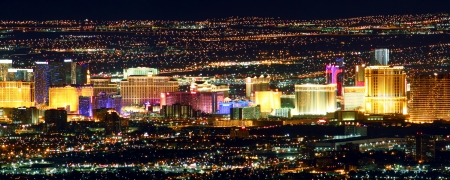 Las Vegas, USA - November 26, 2011: Bright lights of hotels and casinos of the Las Vegas Strip. The Strip is about 4 miles long and is seen here from the Frenchman Mountain summit.