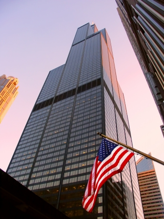Chicago, USA - June 07, 2005: View of the Willis Tower behind an American Flag in Chicago. The building was completed in 1973 and was formerly known as the Sears Tower. Stock Photo - 16285714