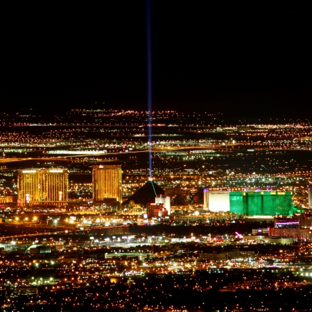 Las Vegas, USA - November 26, 2011: Bright lights of hotels and casinos at the south end of the Las Vegas Strip. The Strip is about 4 miles long and is seen here from the Frenchman Mountain summit.