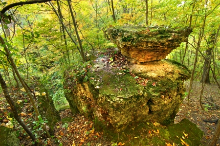 Autumn scenery surrounds an interesting rock formation in Illinois