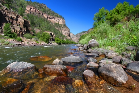 Colorado River flows through the White River National Forest in the western United States photo