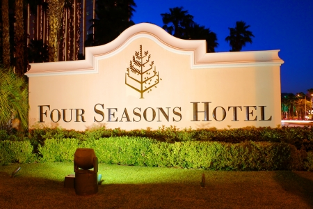 hotel: Las Vegas, USA - May 23, 2012: The Four Seasons Hotel sign in Las Vegas, Nevada.  The Four Seasons operates on the top floors of THEhotel building and opened in 1999.