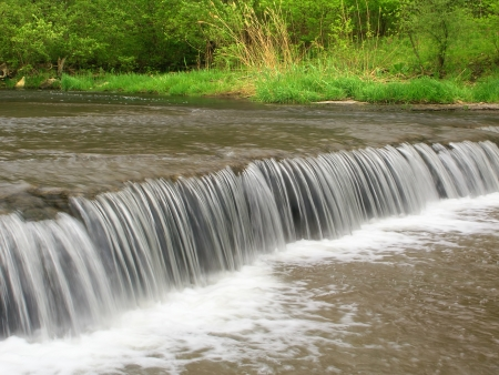 Beautiful waterfall on Prairie Creek of the Des Plaines Conservation Area in Illinois photo