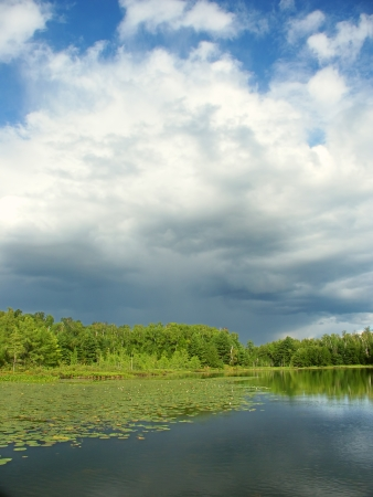 Thunderstorm clouds develop near Mud Lake of northwoods Wisconsin