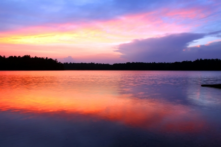 legion: Brilliant colors of sunset over Buffalo Lake in the Northern Highland American Legion State Forest of Wisconsin