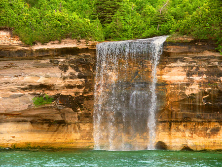 pictured: Spray Falls plunges into Lake Superior at Pictured Rocks National Lakeshore Michigan