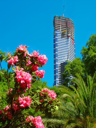 eureka: Melbourne, Australia - November 14, 2005: The Eureka Tower seen from the Royal Botanic Gardens in Melbourne, Australia.  The building is seen here undergoing construction and was eventually completed in 2006. Editorial