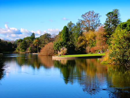 Melbourne, Australia - July 10, 2005: Tourists relax along Ornamental Lake at the Royal Botanic Gardens in Melbourne.