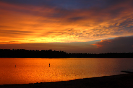 brilliant colors: Brilliant colors of sunset over a northwoods Wisconsin Lake.