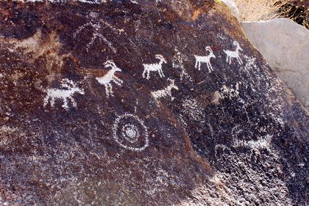 ideogram: Goat petroglyphs on a rock wall at Grapevine Canyon Nevada Stock Photo