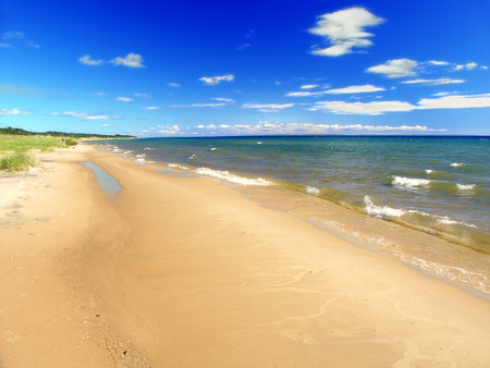 lake beach: Lake Michigan beach on a warm summer day seen from the Upper Peninsula of Michigan Stock Photo