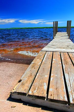 choppy: Wooden dock and choppy waters of Lake Gogebic at Ontonagon County Park Michigan