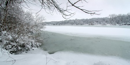 Shoreline of Pierce Lake on a snowy winter day at Rock Cut State Park in Illinois