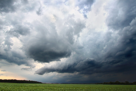 Dark clouds and turbulent skies accompany a strong thunderstorm in Indiana Stock Photo