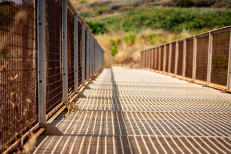 A closeup of a metallic bridge captured on a sunny day