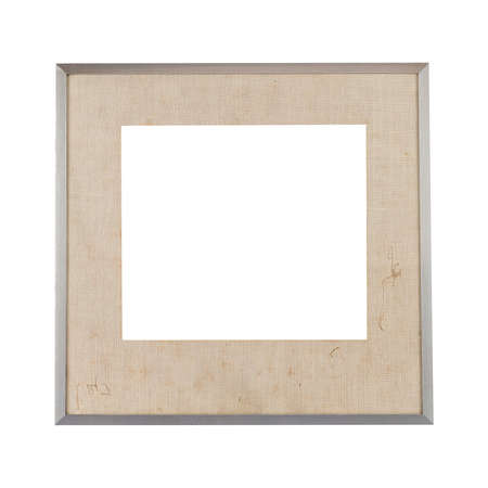 A metal frame with a beige passepartout for painting or picture isolated on a white background